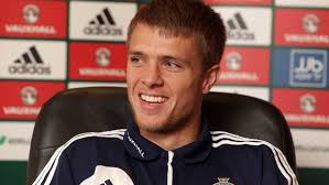 Wardy offers a nervous smile as Geoff Shreeves reads him Boabs piece in a packed press conference.